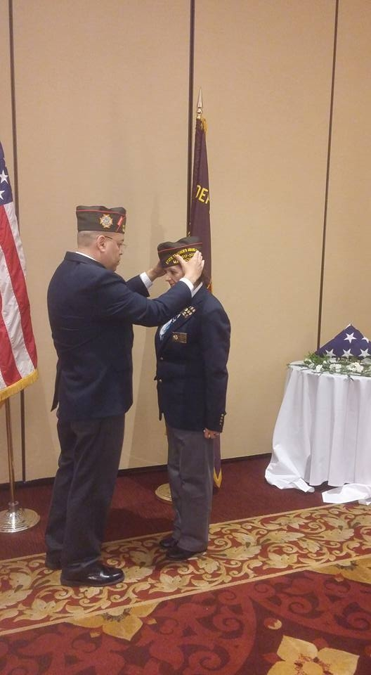 VFW State Commander Eric Segundo Sr. placing new cap on newly installed State Legislative Aid and Post 754 Senior Vice Commander Victor Nunez-Ortiz.