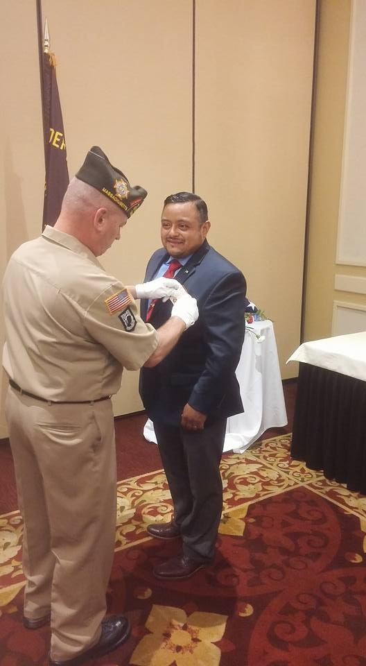 VFW State SGT at Arms Brian Willette replacing newly installed VFW State Legislative Aid Victor Nunez-Ortiz's nametag.