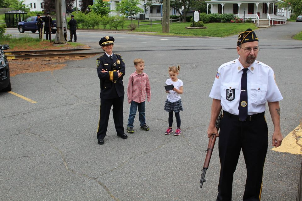 Amherst police Capt. Jennifer Gundersen and her two children, Noah, 7, and Hannah 5 1/2 outside the Amherst VFW, while American Legion Post 148 member stands to the right.
