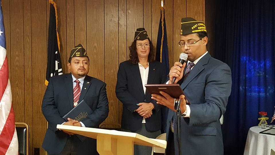 Plaque presentation from new Post 754 Commander Gamalier Rosa to Past Post 754 Commander Victor Nunez-Ortiz for dedication and service to our VFW Post 754 Earl J. Sanders and the Veterans of Foreign Wars of the United States from 2013 to 2017.