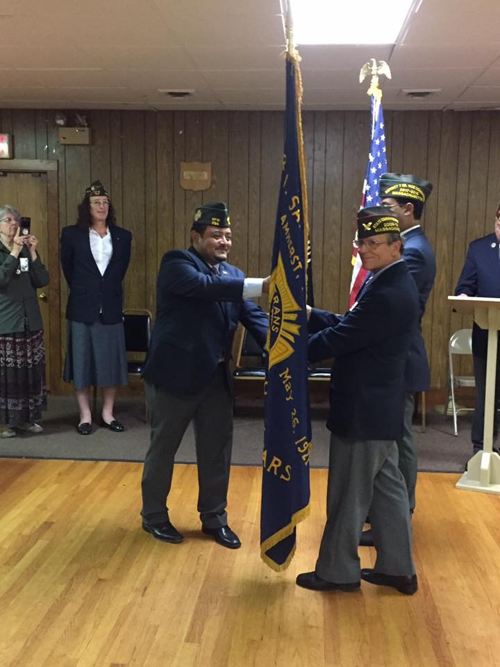 Outgoing Post 754 Commander Victor Nunez-Ortiz surrendering Command through a flag exchange with VFW District 7 Commander John Chadwick, which then is handed to incoming Post 754 Commander Gamalier Rosa.