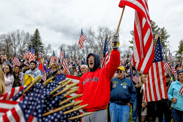 John Milbier Jr. of Springfield, who is the son of a World World II veteran, cheers Nov. 27, 2016 during a protest against Hampshire College's decision to hold off on hoisting the flag in the center of the Amherst campus. The school removed the U.S. flag indefinitely after, since Election Day, it has been set ablaze, replaced, and lowered to half-staff.