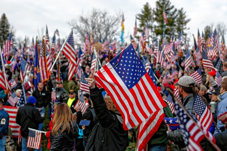 Hundreds rally at Hampshire College on Nov. 27, 2016 to protest the school's decision to hold off on hoisting the flag in the center of the Amherst campus. Hampshire College removed the U.S. flag indefinitely after, since Election Day, it has been set ablaze, replaced, and lowered to half-staff. —GAZETTE STAFF/SARAH CROSBY