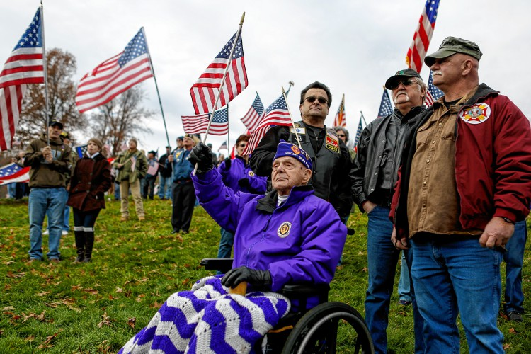 Phillip Girard of Springfield, a 93-year-old U.S. Army veteran, front, John Damario of Wilbraham, a U.S. Marine Corps veteran, Ken Koziol of Wilbraham, a U.S. Army veteran, and Jim Fitzell of Springfield, a U.S. Marine Corps, Army and Air Force veteran, participate in Sunday's protest at Hampshire College. GAZETTE STAFF/SARAH CROSBY