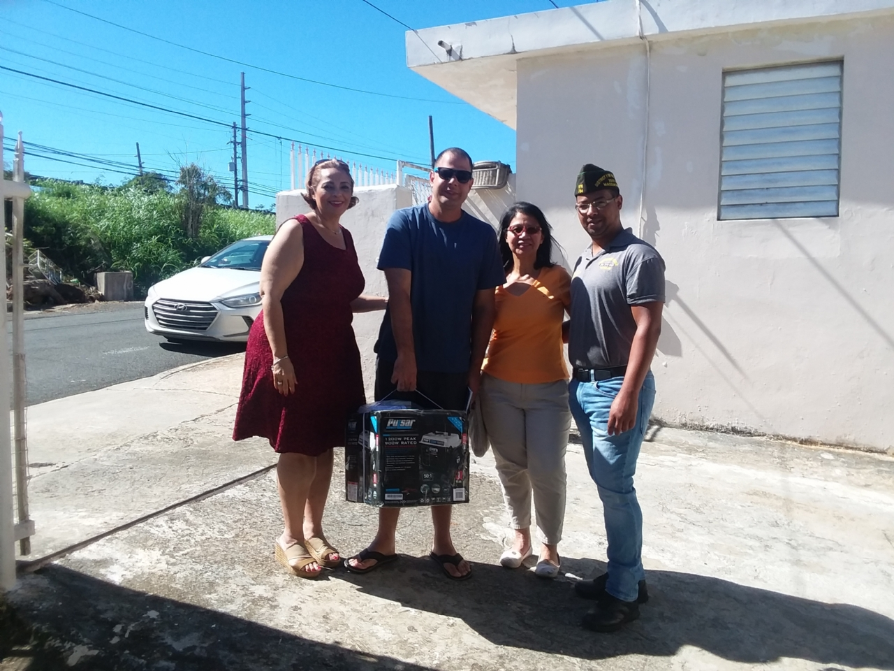 National Director of Housing for Puerto Rico and Representative Noemi Cardona, Veteran dependent Hector Morales, Huerto de Alabanza: Ministerio a las Naciones Pastor Santy Flores and her son, National Deputy Chief Staff,  VDAC Chairman and Post 754 Commander Gamalier Rosa.