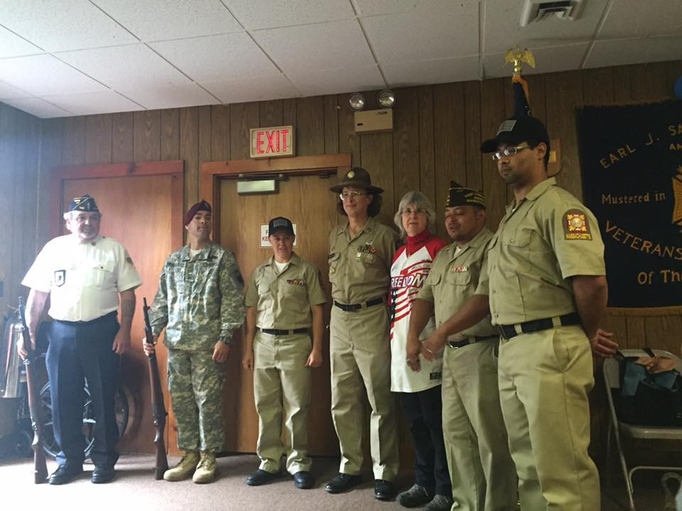 (Left to right) American Legion Post 148 Quartermaster Paul Clevenger, Post 754 Member Rob MacCallister, Post 754 Adjutant Amy Henrikson, Post 754 Trustee Brianna F. MacKinnon, District 7 Auxiliary member Carlyjane Dunn Watson, Post 754 Commander Victor Nunez-Ortiz and Post 754 Senior Vice Commander Gamalier Rosa.