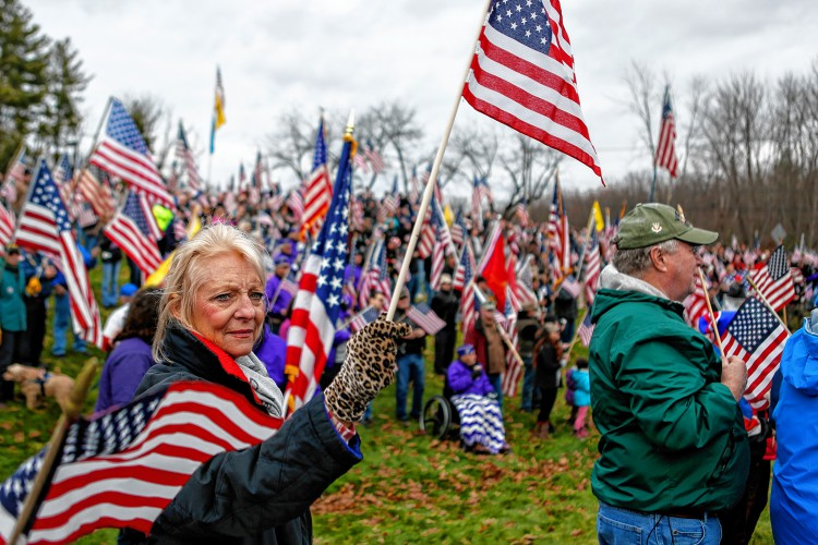 Stacia Salvatore-Roy of Belchertown participates in a Nov. 27, 2016 protest against Hampshire College's decision to hold off on hoisting the flag in the center of the Amherst campus. The school removed the U.S. flag indefinitely after, since Election Day, it has been set ablaze, replaced, and lowered to half-staff.