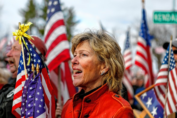 Tricia Pancione of Granby sings Nov. 27, 2016 during a protest against Hampshire College's decision to hold off on hoisting the flag in the center of the Amherst campus. The school removed the U.S. flag indefinitely after, since Election Day, it has been set ablaze, replaced, and lowered to half-staff. —GAZETTE STAFF/SARAH CROSBY